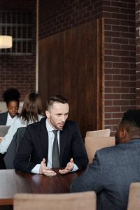Melbourne criminal lawyer talking to a client