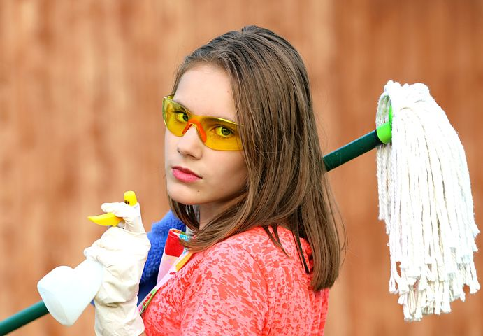 rubbish removal Balmain professional holding a mop