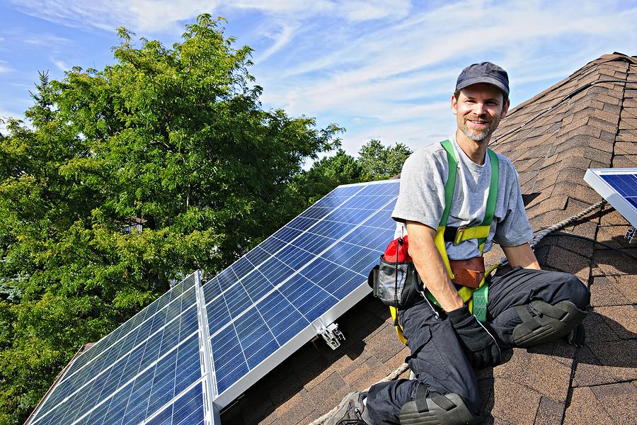 Man providing solar panel financing and installation service