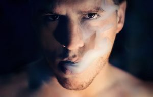 Man with smoke coming out from his mouth