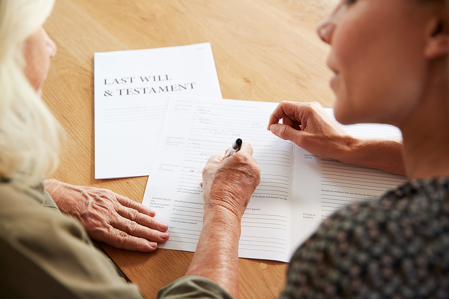 Wills and estate Campbelltown lawyer helping a senior woman