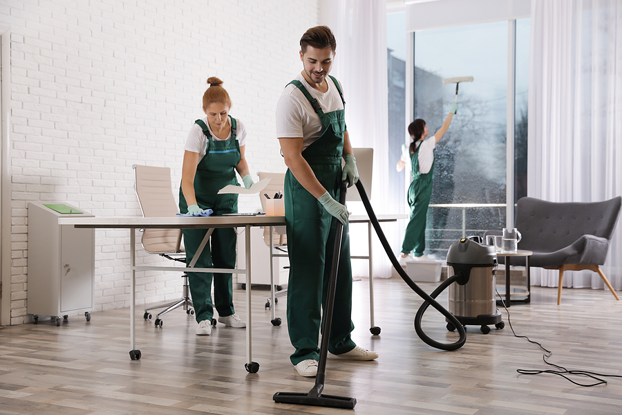 Team of professional janitors offering building cleans